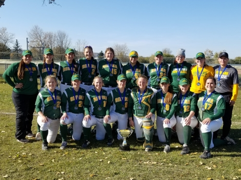 The Regina Cougars team poses on a field