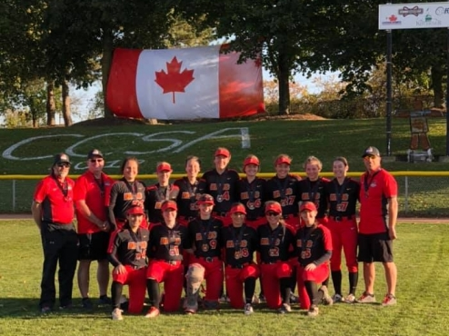 The University of Calgary team poses on a field